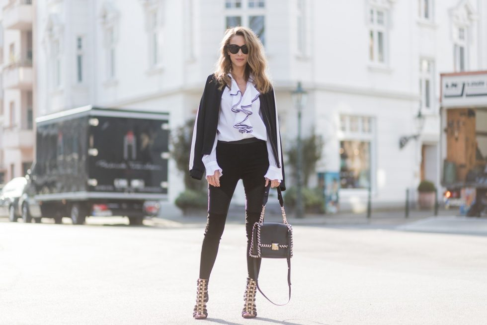 DUESSELDORF, GERMANY - MARCH 30: Model and fashion blogger Alexandra Lapp wearing Karl Lagerfeld, a black leather leggings in biker style from Karl by Karl Lagerfeld, Karl Lagerfeld's shirt which is cut from cotton-poplin and paneled with sheer georgette along the yoke and sleeves, Karl Lagerfeld's bomber jacket, cut from satin and finished with sporty ribbed trims and 'Karl' lettering cursively embroidered across the back, Karl Lagerfeld bag, Celine Audrey sunglasses and sandals by Balmain x H&M on March 30, 2017 in Duesseldorf, Germany. (Photo by Christian Vierig/Getty Images)
