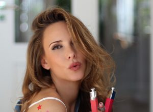 """Alexandra Lapp testing the new Dior Addict Lip Tattoo, the kiss-proof lip stain with its 10-hour """"tattoo"""" tint. The shades boost the natural color of the lips with a subtle luminosity. Long wear tint with extreme weightless feel: Dior color technology blends stains and pigments to create no-transfer shades with a weightless, comfortable, bare-skin sensation."""