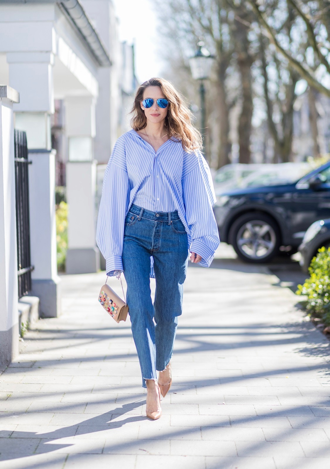 217db9dd6ef ... Model and fashion blogger Alexandra Lapp wearing an oversized navy and  white striped cotton shirt