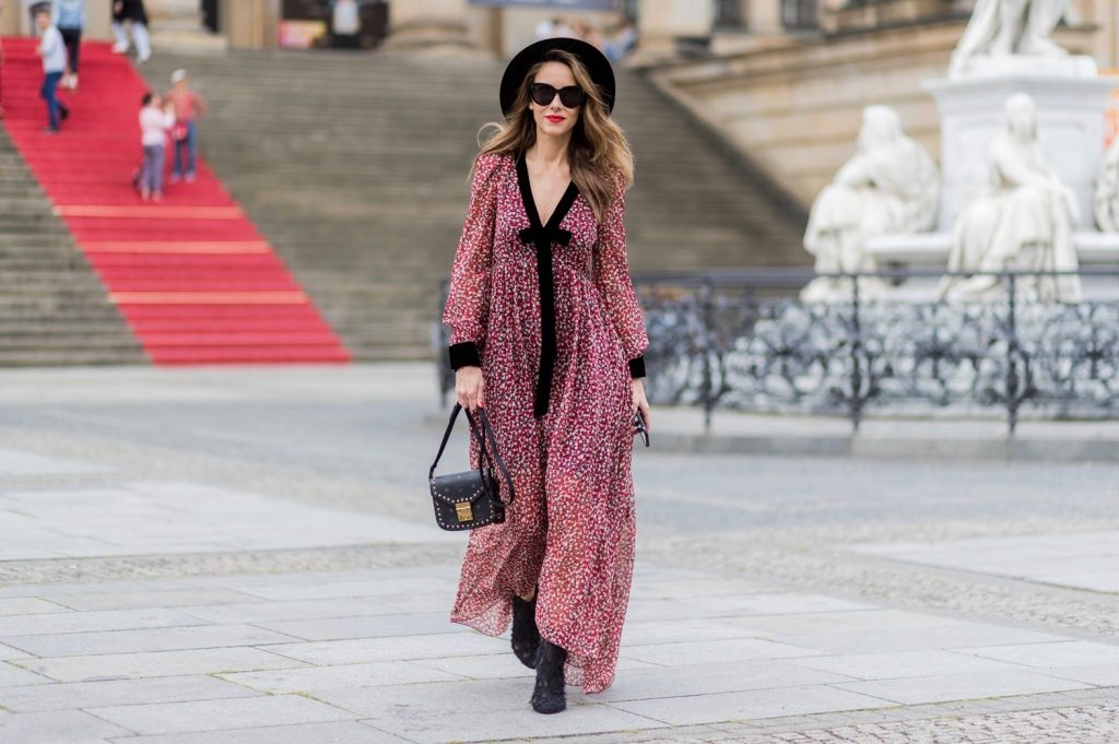 Alexandra Lapp wearing Boho Style, a red and cream floral print maxi dress from Philosophy di Lorenzo Serafini in sheer silk chiffon and bold black trims with a ribbon tie, Toubootfrou ankle boots with rete, organze and suede in black from Christian Louboutin, Celine Audrey sunglasses in black, Maison Maison Michel hat Virginie fedora, MCM Patricia Shoulder Bag in a vintage shape during the Mercedes-Benz Fashion Week Berlin Spring/Summer 2018 on July 7, 2017 in Berlin, Germany. Alexandra Lapp wearing Boho Style, a red and cream floral print maxi dress from Philosophy di Lorenzo Serafini in sheer silk chiffon and bold black trims with a ribbon tie, Toubootfrou ankle boots with rete, organze and suede in black from Christian Louboutin, Celine Audrey sunglasses in black, Maison Maison Michel hat Virginie fedora, MCM Patricia Shoulder Bag in a vintage shape during the Mercedes-Benz Fashion Week Berlin Spring/Summer 2018 on July 7, 2017 in Berlin, Germany.