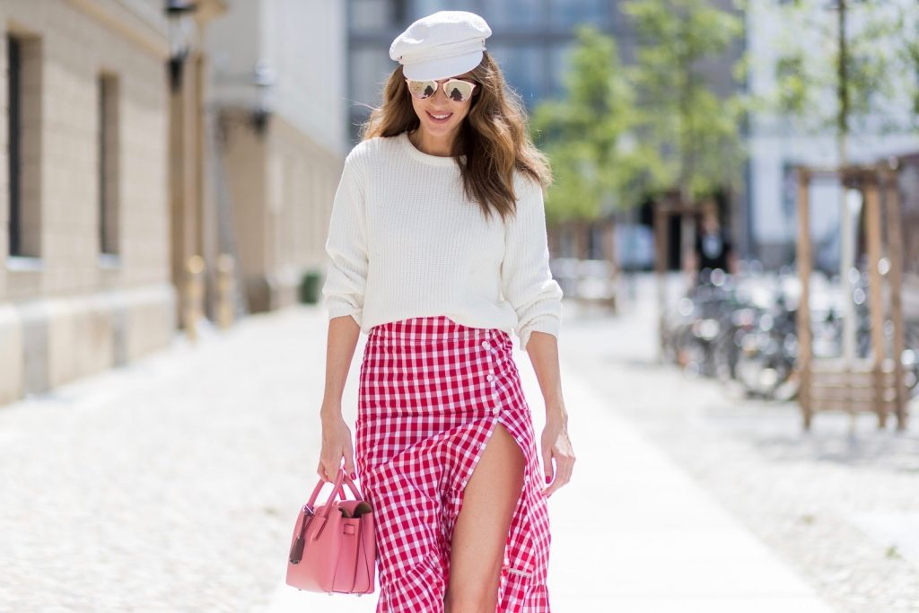 Alexandra Lapp (model, blogger) wearing the Milla Tote bag from MCM which is crafted in Spanish leather, white knitwear from Oui Fashion, Chanel cap in white, Dior Reflected Aviator sunglasses in gold from Dior and Stessy K lip print pumps from Aldo during the Mercedes-Benz Fashion Week Berlin Spring/Summer 2018 on July 6, 2017 in Berlin, Germany.