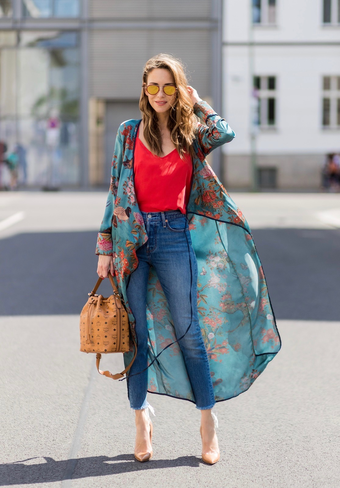 9301010fc16 Model and fashion blogger Alexandra Lapp wearing a wrap dress in Kimono  style from Zara