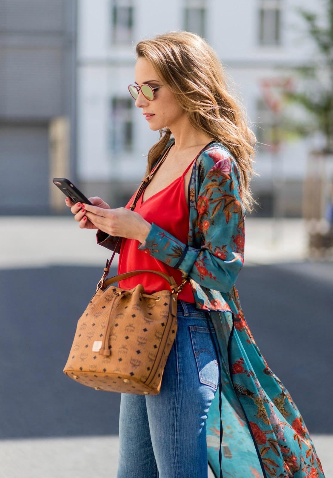 e6d0a3bc ... Model and fashion blogger Alexandra Lapp wearing a wrap dress in Kimono  style from Zara, ...
