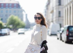 Model and fashion blogger Alexandra Lapp wearing white leather tassel mules from Santoni. a off white cashmere pullover by Heartbreaker, Kimono with velvet collar from Zara, Adriano Goldschmied AG jeans, Roger Viv bag in suede with waterjet cut Guipure detailing, metal buckle and details, removable strap in trapezium shape, silver mirrored sunglasses from Le Spec during the Mercedes-Benz Fashion Week Berlin Spring/Summer 2018 on July 8, 2017 in Berlin, Germany.