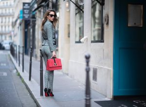Alexandra Lapp seen wearing stirrup pants and blazer in checkered pattern, glencheck and a red bag by Marc Cain, So Kate pumps from Christian Louboutin, Celine Audrey sunglasses and a waist belt by Hermes in the streets of Paris on September 27, 2017 in Paris, France.