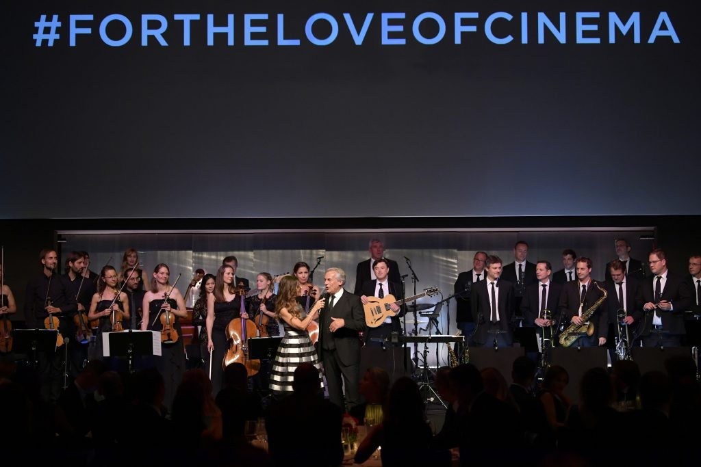 ZURICH Film Festival, SWITZERLAND - SEPTEMBER 30: Host Sandra Studer speaks to bandleader Pepe Lienhard at the IWC 'For the Love of Cinema' Gala Dinner at AURA Zurich on 30 September, 2017 in Zurich, Switzerland. During the event, actor James Marsden presented the third 'Filmmaker Award', a sponsorship worth CHF 100,000. The award was set up by the Association for the Promotion of Film in Switzerland ('Verein zur Filmförderung in der Schweiz'). (Photo by Harold Cunningham/Getty Images for IWC)