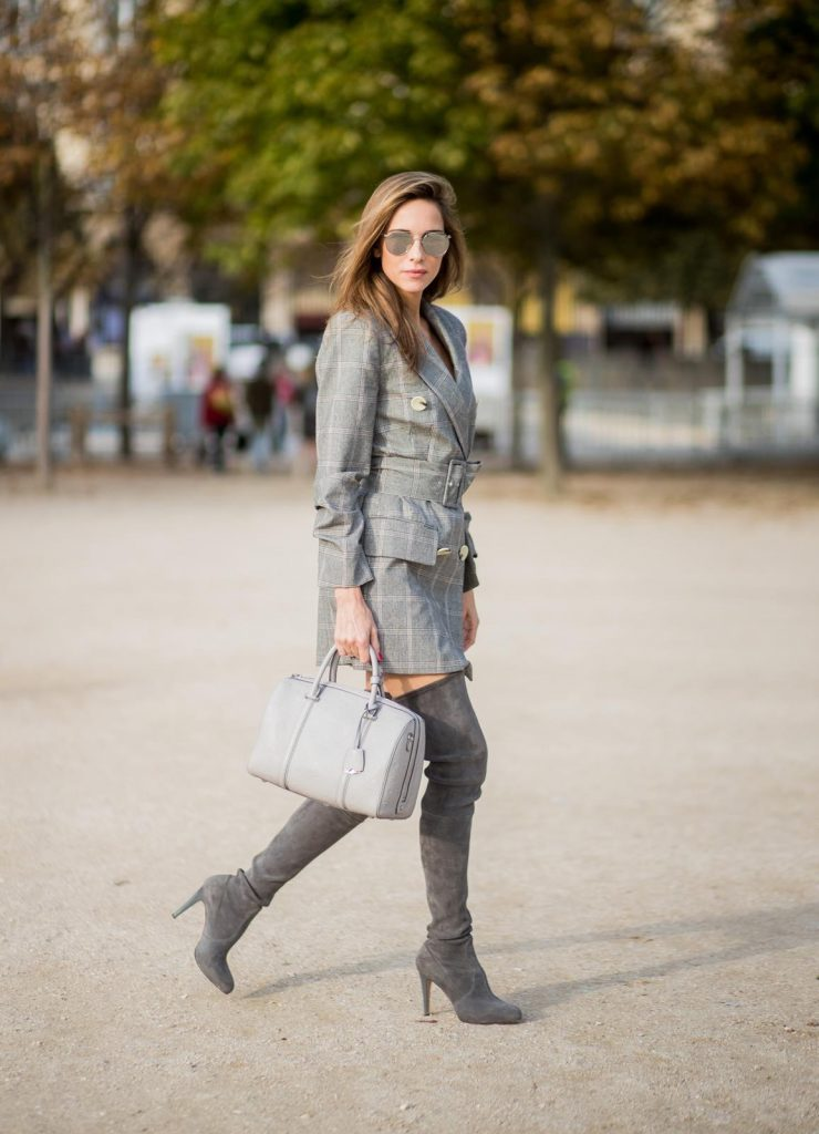 Alexandra Lapp wearing plaid blazer dress with a waist belt from Zara, the Essential Boston Bag with Monogramm in grey by MCM, silver mirrored sunglasses from le Specs, grey suede overknee boots by Gianvito Rossi is seen during Paris Fashion Week Spring/Summer 2018 on September 28, 2017 in Paris, France.