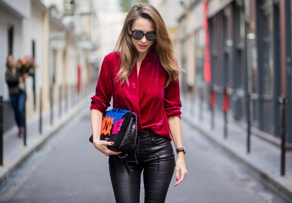 Alexandra Lapp having a velvet crush, wearing a velvet blazer from Jadicted in burgundy red, leather pants in black with laced high waist and ankle zippers from Unravel, Chanel lambskin bag printed with Chanel No.5 from the supermarket collection by Chanel, Diormania sunglasses by Dior, Opyum 110 lacquer ankle boots from Saint Laurent, and mother fucker socks from Mother Denim is seen during Paris Fashion Week Spring/Summer 2018 on September 29, 2017 in Paris, France.