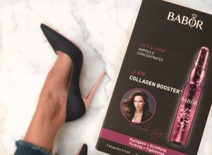 Alexandra Lapp says - I am Collagen Booster, holding the new Babor Ampoules in her hands while wearing Christian Louboutin denim heels.