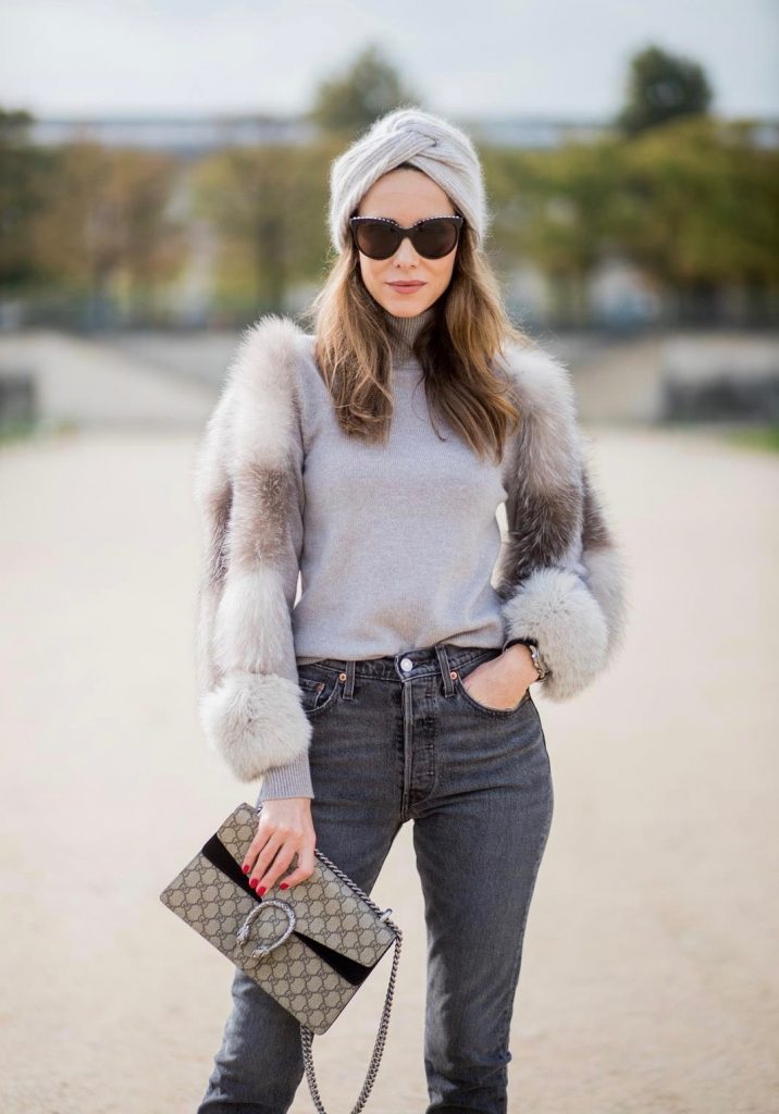 Alexandra Lapp wearing turban style in Paris, a cashmere turban from Falconeri, cashmere turtleneck pullover with fur sleeves from Falconeri, Levis 501 Skinny Fit jeans in black, sunglasses with pearls from Chanel, beige suede ankle boots by Gianvito Rossi and Dionysus GG Supreme shoulder bag from Gucci is seen during Paris Fashion Week Spring/Summer 2018 on September 29, 2017 in Paris, France.