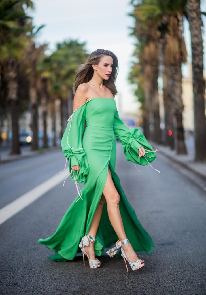 BARCELONA, SPAIN - NOVEMBER 27: Hawaiin vibes in Barcelona, Alexandra Lapp wearing a green long dress from Lana Mueller and Christian Louboutin multicolor heels on November 27, 2017 in Barcelona, Spain.