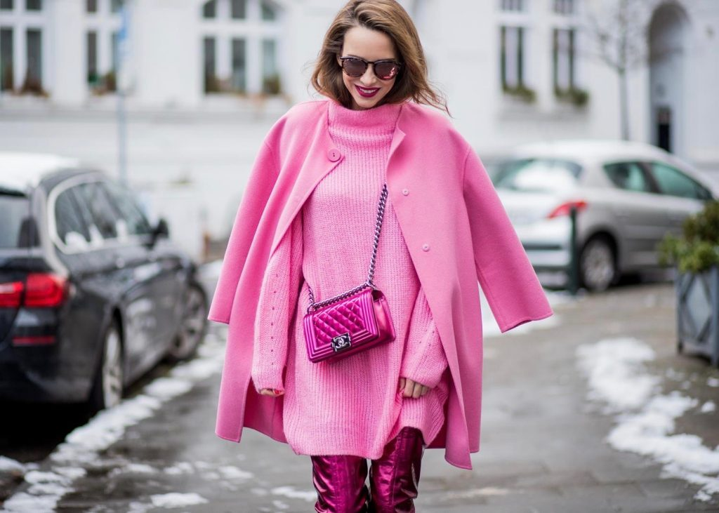 On Wednesdays we wear pink, Alexandra Lapp wearing overknee boots in metallic pink from Christian Louboutin, metallic pink Boy bag from Chanel, pink sunglasses from Le Specs, light pink knit dress from H&M and light pink cashmere coat from Prada on December 10, 2017 in Duesseldorf, Germany.
