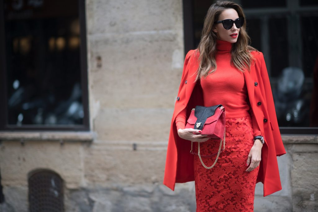 Alexandra Lapp seen wearing an orange outfit from Marc Cain, Manolo Blahnik heels in black with orange and Céline Audrey sunglasses, in the streets of Paris on September 27, 2017 in Paris, France.