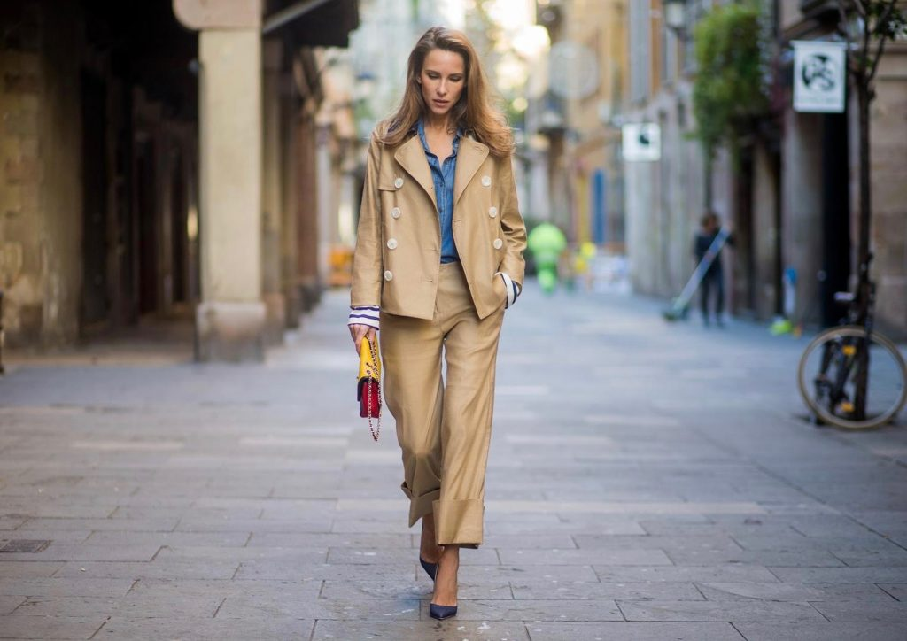 BARCELONA, SPAIN - NOVEMBER 27: Alexandra Lapp wearing Safari look, wide cut khaki pants from Steffen Schraut, khaki jacket with blue collar and blue and white strips on the bottom of the sleeve from Steffen Schraut, denim shirt by Steffen Schraut, So Kate Pumps from Christian Louboutin in denim, Chanel 2.55 bag in red, blue and yellow with golden logo buckle on November 27, 2017 in Barcelona, Spain.