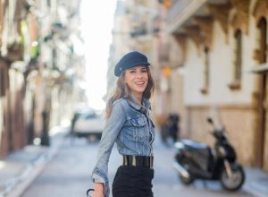 BARCELONA, SPAIN - NOVEMBER 29: Alexandra Lapp wearing a suede leather fringe suede skirt in black from Set Fashion, light blue vintage jeans jacket by Levis, black lacquer waist belt by Gucci, Pigalle Christian Louboutin pumps in black lacquer, MCM shoulder bag and a vintage Chanel cap on November 29, 2017 in Barcelona, Spain.