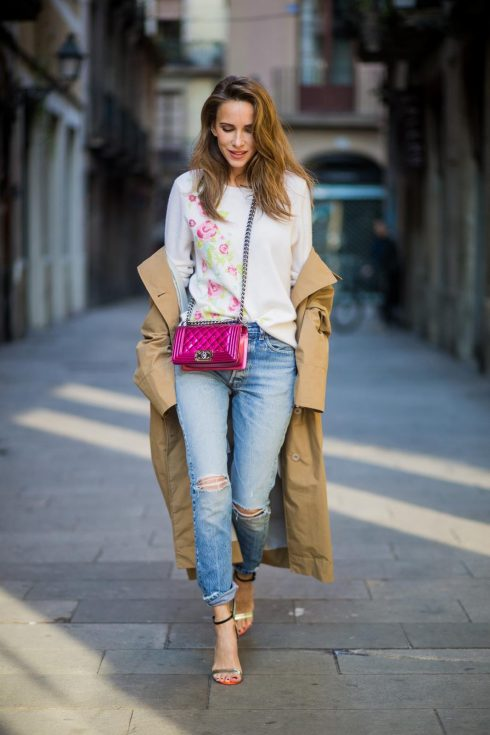 BARCELONA, SPAIN - NOVEMBER 29: Trench coat Hype in Barcelona, Alexandra Lapp wearing and beige oversized egg shaped Audrey trench coat from G-Lab, off-white round neck cashmere pullover with flower applications in pastel tones, vintage Leviss from Re Done, Sophia Webster Chiara sandal heels with a butterfly at the back and Chanel Boy bag in patent pink on November 29, 2017 in Barcelona, Spain.