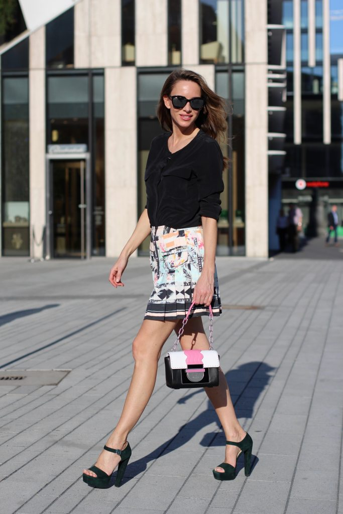#AIGNERLOVE - DUESSELDORF, May 2018, Model and Blogger Alexandra Lapp wearing the it-bag Aigner Candice bag S in pink with black and white.