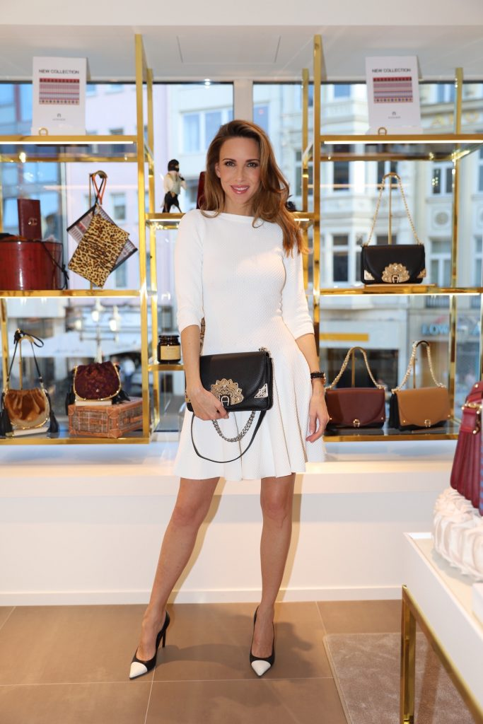 #AIGNERLOVE - Bonn, May 2018, Model and Blogger Alexandra Lapp at the Aigner store re-opening in Bonn, wearing an Alaïa dress in white, black an white Saint Laurent pumps and the it-bag Aigner Candice bag S in pink with black and white combined with the Love shoulder strap.