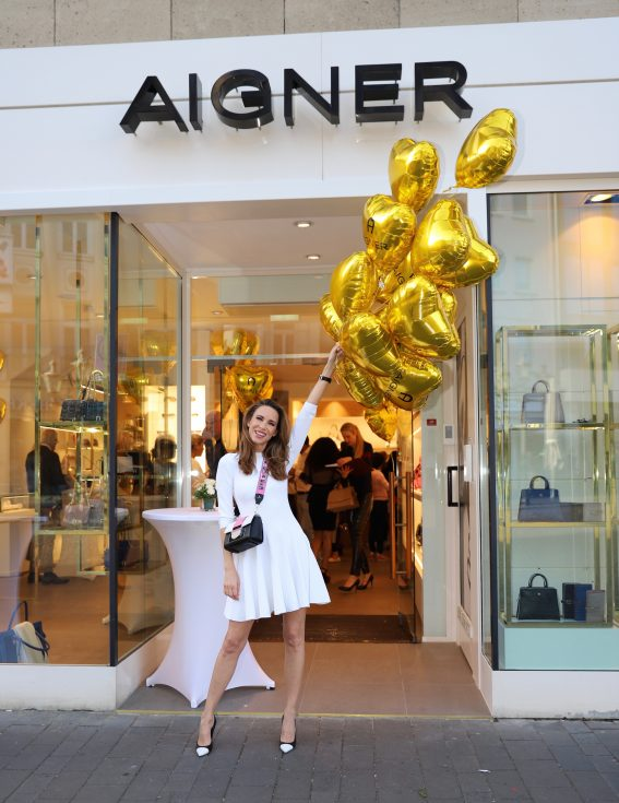 #AIGNERLOVE - Bonn, May 2018, Model and Blogger Alexandra Lapp at the re-opening Aigner store in Bonn, wearing an Alaïa dress in white, black an white Saint Laurent pumps and the it-bag Aigner Candice bag S in pink with black and white combined with the Love shoulder strap.