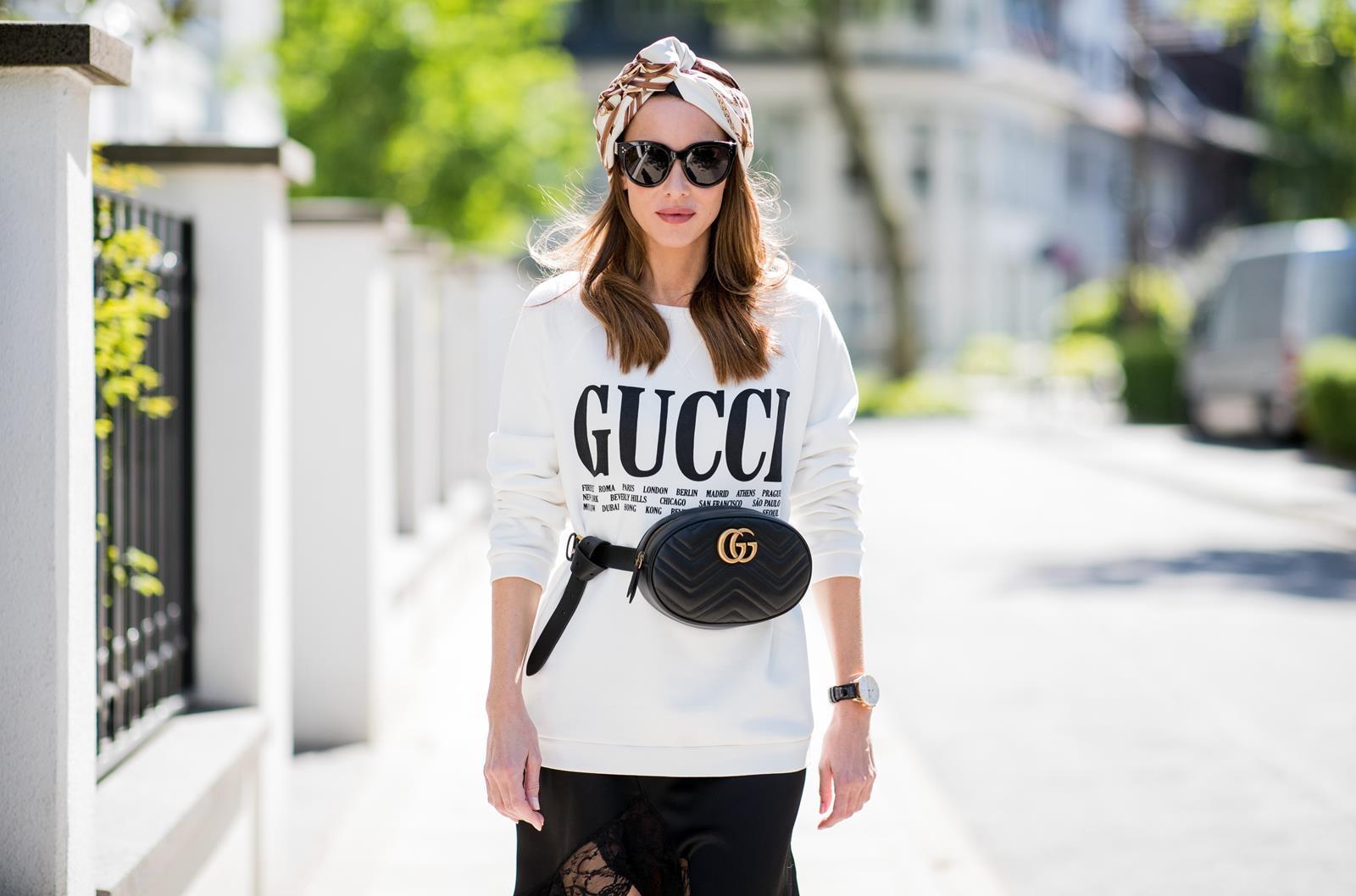 8c5c5c26bd7f ... Alexandra Lapp wearing a Gucci Belt Bag Look with a white crew-neck  cotton sweatshirt · «