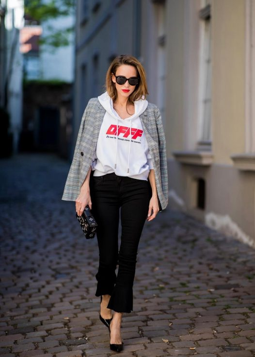 Alexandra Lapp wearing the Off-White Hoodie co Virgil Abloh 0777 cotton Terry Hoodie in white, multicolored plaid Madeleine blazer by Anine Bing, the Cha Cha Fray flared pants in black by Mother, black patent leather pumps by Christian Louboutin, a black Petite Malle with silver accessories by Louis Vuitton and black Diormania sunglasses by Dior on May 6, 2018 in Duesseldorf, Germany.