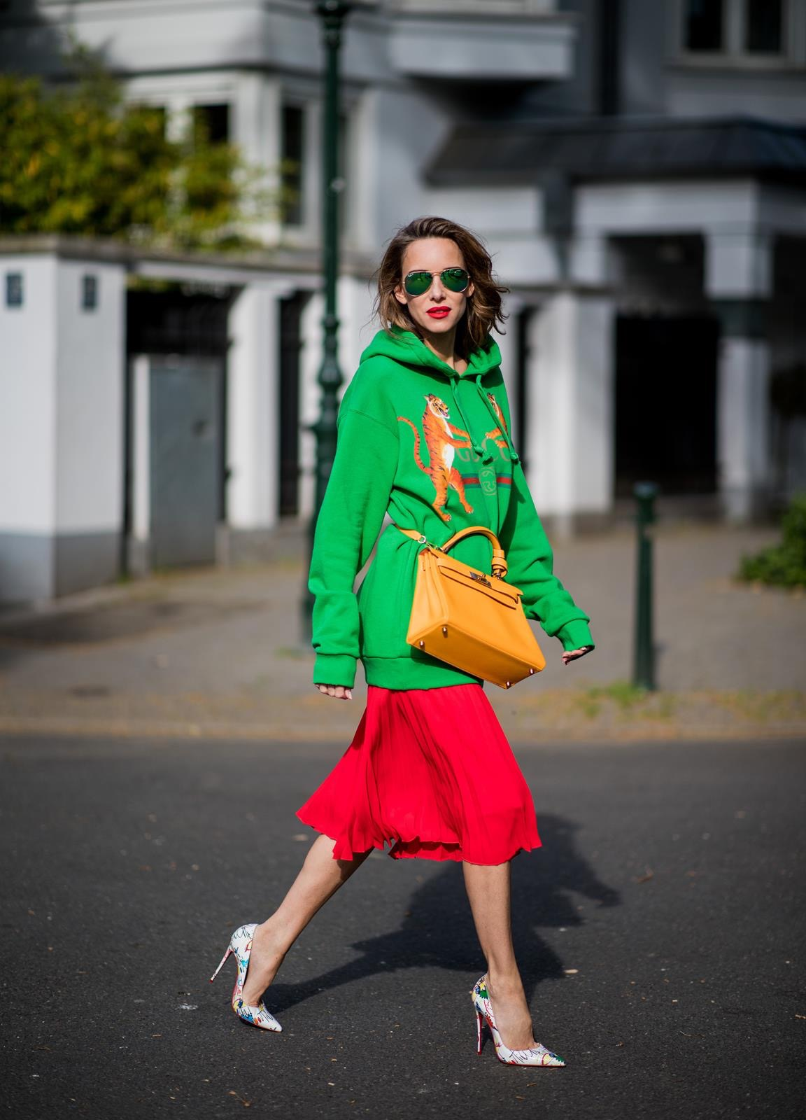 9ff3697ee42 ... Alexandra Lapp in a Hermès Kelly Look wearing a green tiger print Gucci  logo hoodie
