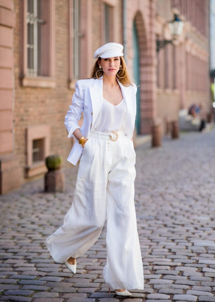 Alexandra Lapp in all white everything wearing a white cotton blazer with gold buttons by Balmain, linen Palazzo pants with a high waist belt in white by Zimmermann, a white Jadicted silk top, white Pigalle Python pumps by Christian Louboutin, vintage Chanel bakerboy cap in white, huge golden hoop earrings with gold framed pearls and a bracelet in gold both vintage from Chanel on May 6, 2018 in Duesseldorf, Germany.
