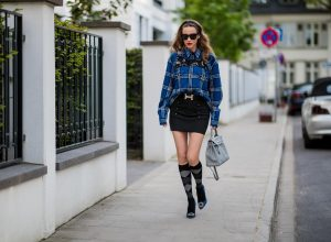 Alexandra Lapp in a Burlington Socks | Hairband Style wearing a blue embroidered check shirt by Gucci, a black wool skirt by Isabel Marant, blue Hangisi satin Manolo Blahnik pumps, grey black knee-high Burlington socks, a grey Hermes Birkin bag, a vintage black Hermes belt and black Celine sunglasses on May 3, 2018 in Duesseldorf, Germany.