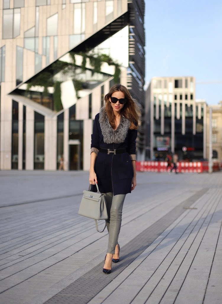 Model and Blogger Alexandra Lapp in a Long Cardigan Look wearing a long cardigan coat by Airfield, grey leather pants from Jbrand, black So Kate Heels from Christian Louboutin, grey Kelly bag by Hermès, vintage Buckle belt from Hermès and black Audrey sunglasses by Céline.