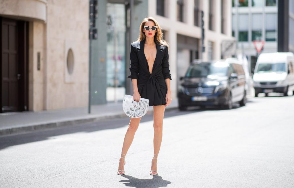 Alexandra Lapp in Jacquemus Love wearing 'La veste Rafael' drapped black tailored dress jacket by Jacquemus, Inez sandals by Saint Laurent in Blanc Optique, Victoire Sunglasses in white by Saint Laurent and bag Gaias Ark in white by Cult Gaia during the Berlin Fashion Week July 2018 on July 6, 2018 in Berlin, Germany.