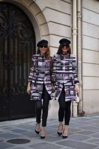 Alexandra Lapp in a Twinning Look with Lena Terlutter wearing a multi-colored Blazer Jacket in jersey jacquard by Airfield, black leather pants from Current Elliott, a simple white T-Shirt from Vince, vintage Chanel bakerboy cap in black, High Heels in black by Christian Louboutin and cat-eyed sunglasses in black by Illesteva.