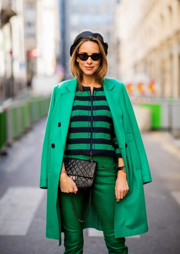 Alexandra Lapp in a Go Green Look wearing green skinny Riani leather pants, black green striped knit with a zipper by Riani, a green oversized blazer jacket by Riani, a black Chanel 2.55 flap bag, black suede Christian Louboutin high heels, cat-eye shaped Isabella Sunglasses by illesteva and a black Eugenia Kim beret during Paris Fashion Week Womenswear Spring/Summer 2019 on September 27, 2018 in Paris, France.