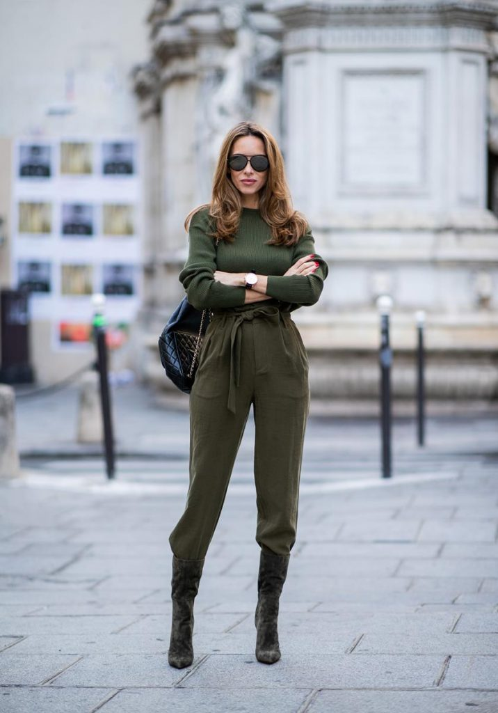 Alexandra Lapp in an Olive Green Tones Look wearing a slim cut Merino pullover in dark green from SET Fashion, green culotte trousers with protruding waistband from SET Fashion, a vintage backpack in black from Chanel with golden chains, green suede boots from Santoni ruffled in the back and black Audrey sunglasses from Céline during Paris Fashion Week Womenswear Spring/Summer 2019 on September 27, 2018 in Paris, France.