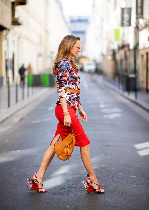 Alexandra Lapp in a Prada Flame Sandals / Graphic Pattern Look wearing a Cindy Blazer with graphic pattern by Airfield, a red leather pencil skirt by American Retro, red flame wedge sandal heels from Prada and a vintage Dior saddle bag in cognac, Gucci cat-eye radiant ivory sunglasses and brown cognac soft leather belt by Prada is seen during Paris Fashion Week Womenswear Spring/Summer 2019 on September 25, 2018 in Paris, France.