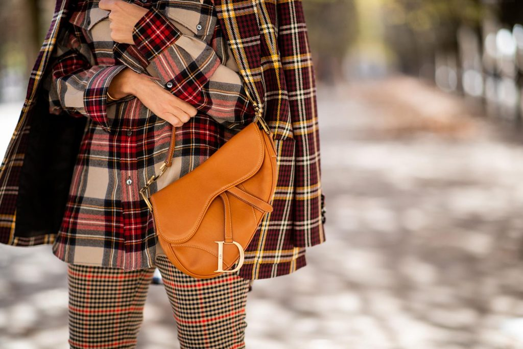 Alexandra Lapp in a Plaid Allover Look is wearing a burgundy and yellow checked wool blazer from Burberry, embroidered checked oversized shirt in red, black, white by Gucci, multi-coloured high-waisted checked trousers from P.A.R.O.S.H., browny embossed leather belt by Max Mara, a vintage Dior saddle bag in cognac, purple Gianvito Rosso boots and black Audrey sunglasses by Celine during Paris Fashion Week Womenswear Spring/Summer 2019 on September 25, 2018 in Paris, France.