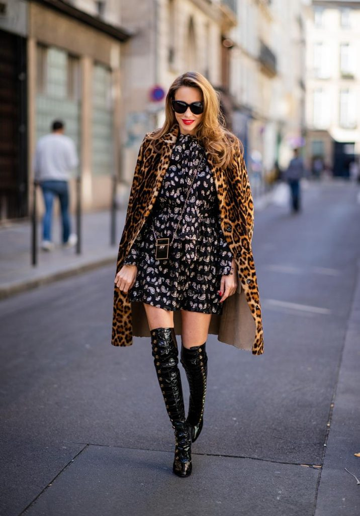 pfw_ss19_day7-12 (CopyAlexandra Lapp in a Saint Laurent dress Look wearing a glitter paisley patterned dress by Saint Laurent, a reversible Shearling Trench Coat in a leopard look by Yves Salomon, Frenchissima Alta Overknees in patent soft black leather by Christian Louboutin, a Roger Vivier Stars Rivets leather cigarette case with a long golden chain and black Audrey sunglasses by Celine is seen during Paris Fashion Week Womenswear Spring/Summer 2019 on October 1, 2018 in Paris, France.