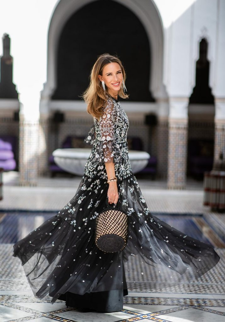 Alexandra Lapp at La Mamounia wearing a Dragonfly Garden embellished tulle and crepe de chine maxi dress in black and silver by Needle & Thread, black pumps Flower Strass Buckle from Roger Vivier and long silver strass earrings by H&M on November 27, 2018 in Marrakech, Morocco.