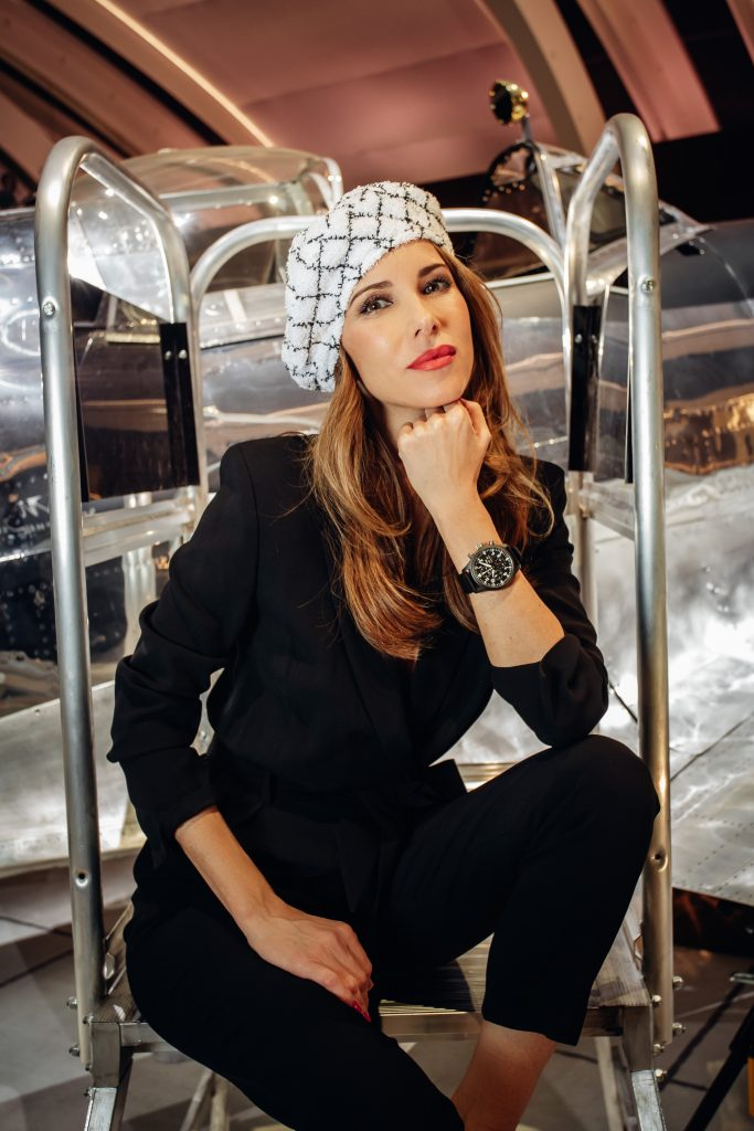 Alexandra Lapp in a Silver Spitfire Look, wearing a IWC Spitfire watch while visiting the IWC Schaffhausen booth at the SIHH 2019 in Geneva.
