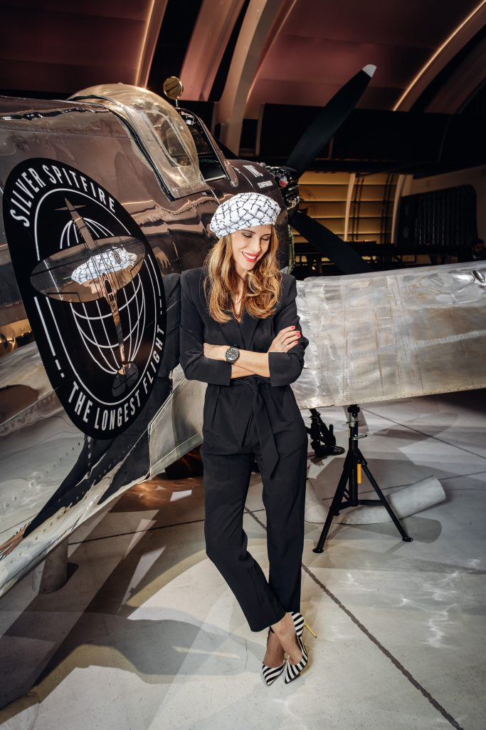 AlexAlexandra Lapp in a Silver Spitfire Look, wearing a IWC Spitfire watch while visiting the IWC Schaffhausen booth at the SIHH 2019 in Geneva.