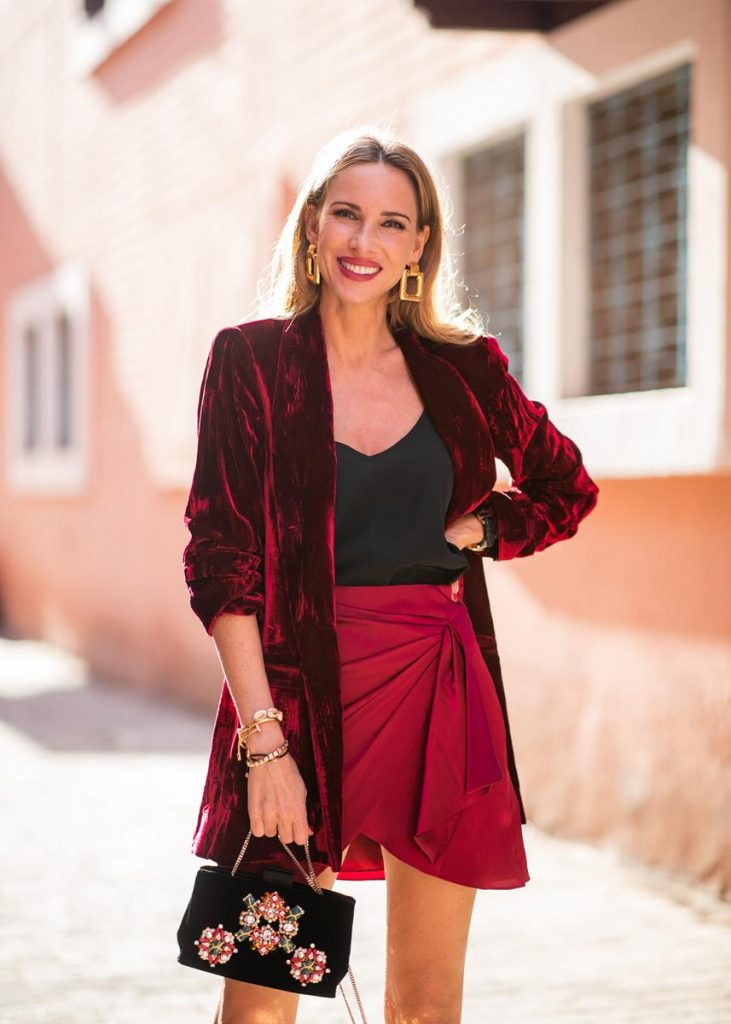 Alexandra Lapp in a wrap skirt look wearing a loose fit crushed velvet red blazer from Alice + Olivia, a black top from Jadicted, a satin red mini skirt with a rap-effect from Caroline Constas, a black velvet handbag with sparkling stones and pearls from Roger Vivier, black woven Sienna sandals from Cult Gaia, gold earrings from Zara on November 26, 2018 in Marrakech, Morocco. (Photo by Christian Vierig/Getty Images)