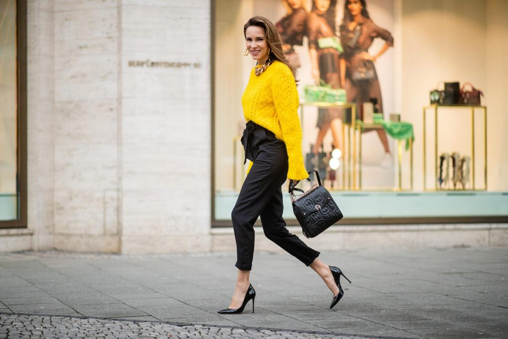 Alexandra Lapp in a Diadora Backpack look, wearing a cropped yellow cable knit sweater from R13 with paperbag pants from H&M, Gianvito Rossi patent leather pumps, Zara earrings and a H&M statement necklace and Aigner Diadora M backpack in during the Berlin Fashion Week Autumn/Winter 2019 on January 17, 2019 in Berlin, Germany. (Photo by Christian Vierig/Getty Images)