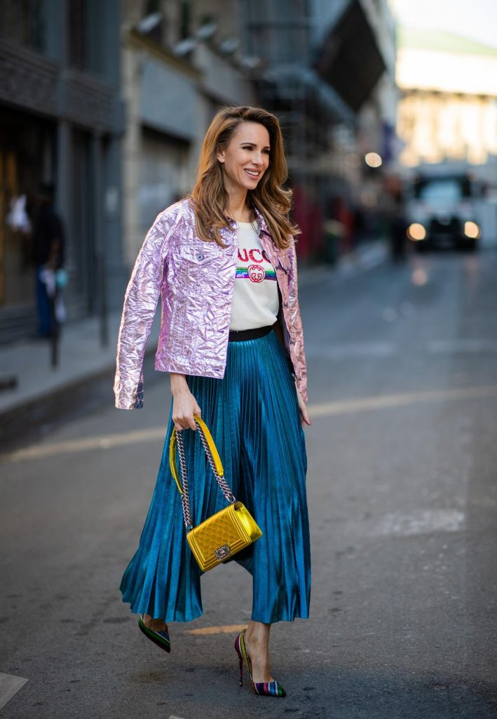 Alexandra Lapp in a Metallic Fashion look, wearing the crinkled Alby laminated jacket from Sies Marjan, a pleated metallic skirt from ROQA in turquoise, a white logo print Gucci t-shirt, Chanel Boy bag in gold, Audrey sunglasses from Celine during Paris Fashion Week Womenswear Fall/Winter 2019/2020 on February 25, 2019 in Paris, France. (Photo by Christian Vierig/Getty Images)