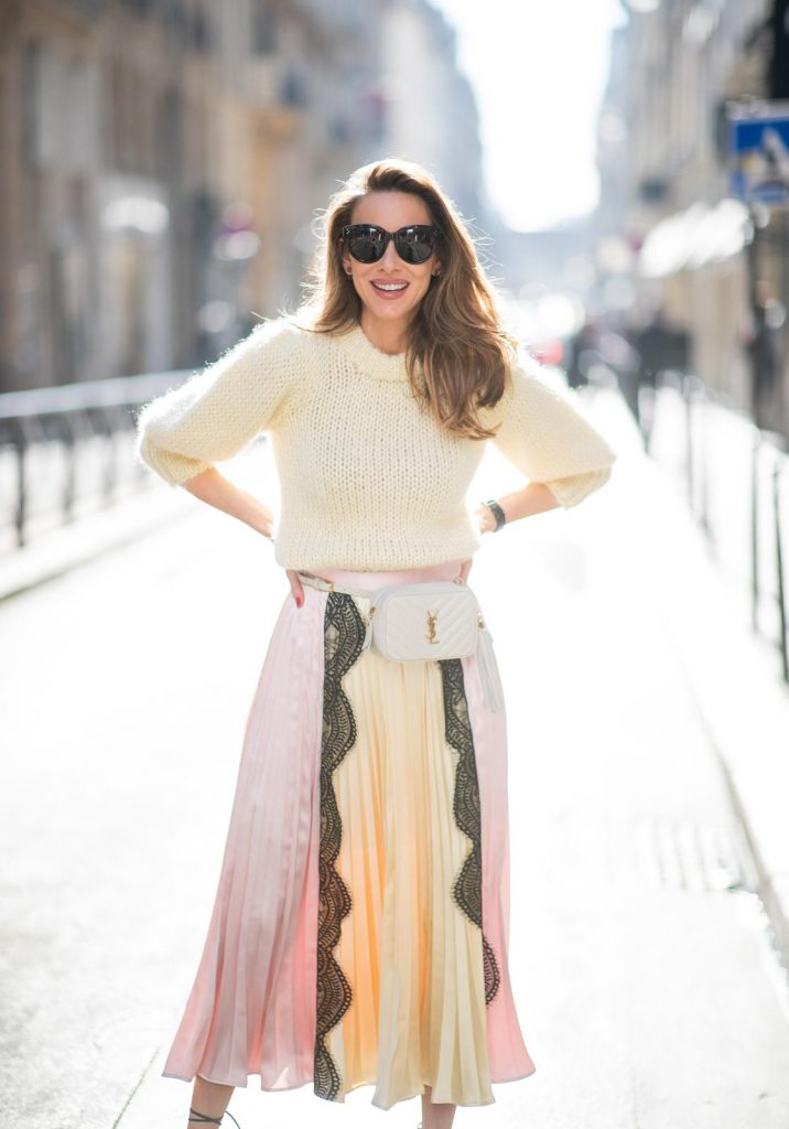 Alexandra Lapp in a Fashion Double look, wearing a chunky knit sweater from Ganni, a multi colored Self-Portrait plissée-skirt, Saint Laurent Blanc Vi belt bag, black Gianvito Rossi sandals and Céline Audrey sunglasses and Isabel Lapp is seen wearing a Sandro suit with double breasted blazer in light pink and matching high waisted pants, Saint Laurent mini bag, Isabel Marant heels and Céline Shadow sunglasses, all by Breuninger, seen during Paris Fashion Week Womenswear Fall/Winter 2019/2020 on February 27, 2019 in Paris, France. (Photo by Christian Vierig/Getty Images)