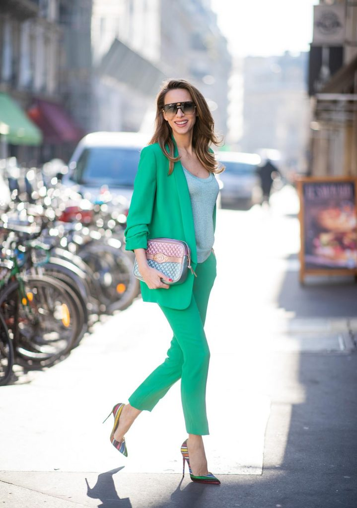 Alexandra Lapp in a Green Suit look wearing a green suit combination by Steffen Schraut with a long blazer with a 3/4 length sleeve blazer and matching 7/8 length pants, Missoni tank top, Gucci Trapuntata bag in turquoise/pink/gold, So Kate Suede Stripyglitter - Version Multi pumps from Christian Louboutin during Paris Fashion Week Womenswear Fall/Winter 2019/2020 on February 26, 2019 in Paris, France. (Photo by Christian Vierig/Getty Images)