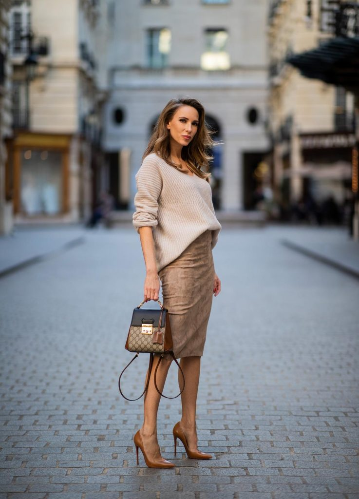 Alexandra Lapp is seen wearing a brown fitted suede leather skirt from Arma, a loose beige knit sweater from Sminfinity, Gucci backpack So Kate pumps in cognac during Paris Fashion Week Womenswear Fall/Winter 2019/2020 on February 25, 2019 in Paris, France. (Photo by Christian Vierig/Getty Images)