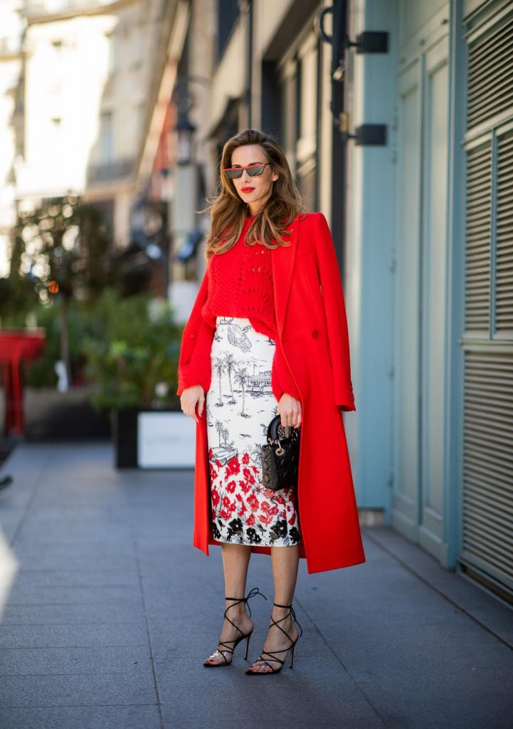 pfw_aw19_day2-91 (Copy)Alexandra Lapp in a Printed Skirt look, wearing a fitted two button coat in bright red from Givenchy, with a NO.21 sequined twill pencil skirt with a Palm-print, a red wool loose knit sweater from Ganni - all from Breuninger, black sandals from Gianvito Rossi, Prada cat-eye shaped sunglasses with red details and the Lady Dior mini bag during Paris Fashion Week Womenswear Fall/Winter 2019/2020 on February 26, 2019 in Paris, France. (Photo by Christian Vierig/Getty Images)