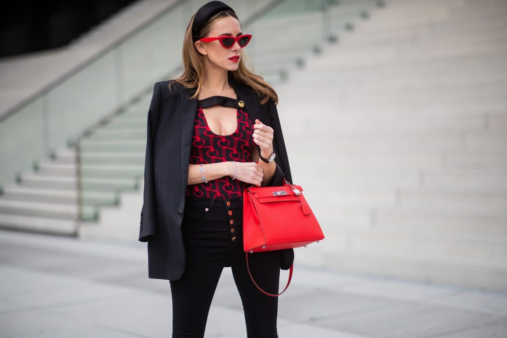 Alexandra Lapp in a Prada Bodysuit look wearing the SS19 black and red Prada Jacquard Jersey Body, black satin headband by Prada, red Hermes Kelly bag, red Cat-eye Celine sunglasses, Saint Laurent black classic jacket, Veronica Beard Debbie jeans in black on May 03, 2019 in Duesseldorf, Germany. (Photo by Christian Vierig/Getty Images)