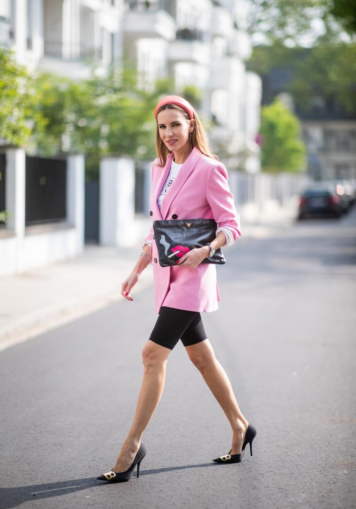 Alexandra Lapp in a cycling pants look, wearing a pink oversized blazer from Zara, a logo print t-shirt in black and white from Balenciaga, biker / cycling shorts from H&M, a pink silk satin hairband from Prada, a black clutch with a smoking red mouth print from Prada and the black pointed BB pumps from Balenciaga on May 04, 2019 in Duesseldorf, Germany. (Photo by Christian Vierig/Getty Images)