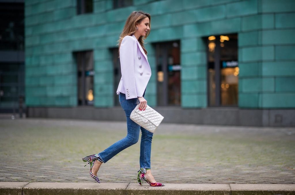 Alexandra Lapp in a Balenciaga Blazer look, wearing a pastel lilac double breasted blazer from Balenciaga, a pastel t-shirt with a logo print from Balmain, high rise skinny jeans Olivia from Citizens of Humanity, a vintage silver flap bag by Chanel and the Toubinana 80 Satin Cinestripes Multicolored Pumps from Christian Louboutin on May 01, 2019 in Duesseldorf, Germany. (Photo by Christian Vierig/Getty Images)