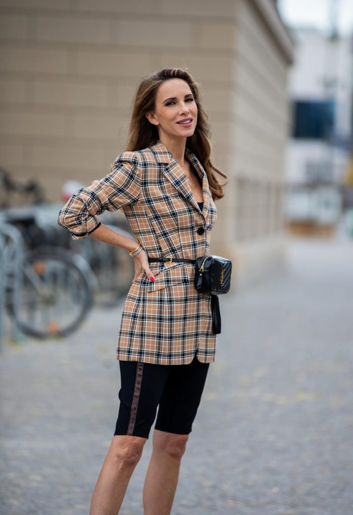 Alexandra Lapp is seen wearing a beige brown checkered blazer, black cycling pants and black bucket hat from Riani, Céline Audrey sunglasses, black St. Laurent Lou belt bag and black Gianvito Rossi patent leather pumps during Berlin Fashion Week on July 02, 2019 in Berlin, Germany. (Photo by Christian Vierig/Getty Images)